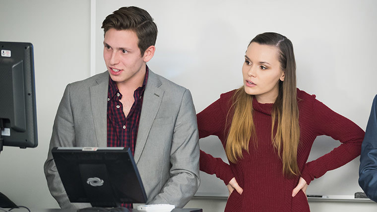 Two students presenting to a class.